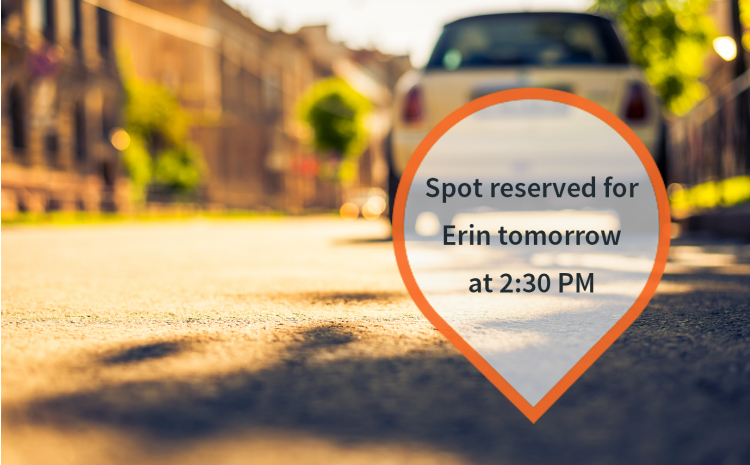 A parking spot with a pin that reads 'Spot reserved to Erin tomorrow at 2:30 pm'